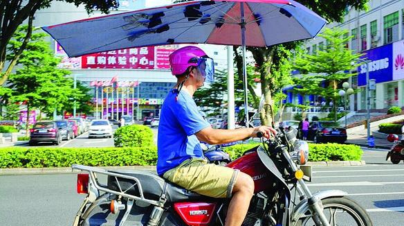 惠州电动车加装遮阳伞要罚500元并没收伞具